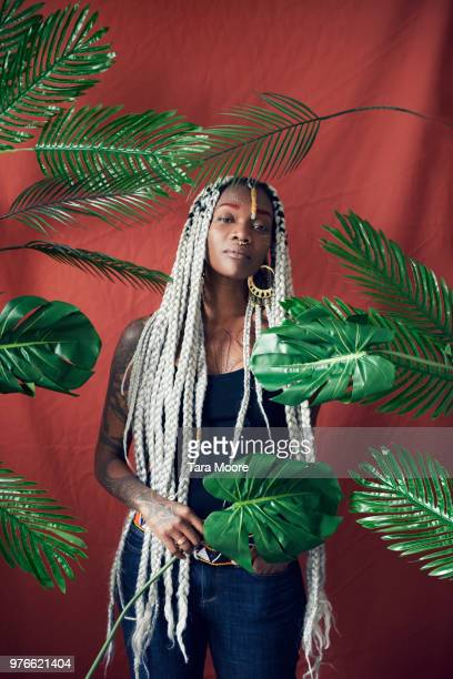 urn=ban woman surrounded by leaves
