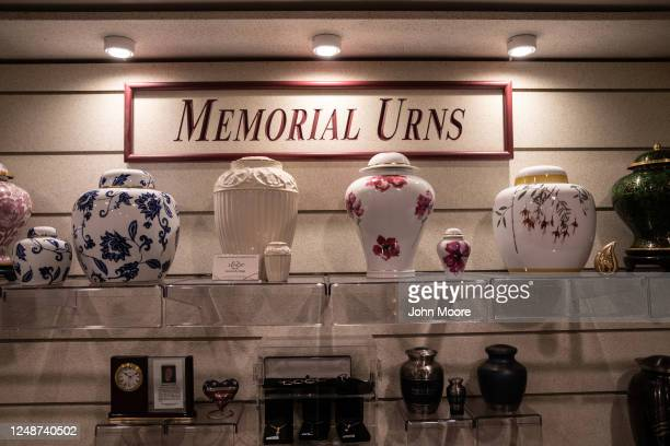Urns sit on display in the showroom at the Clayton and McGirr Funeral Home on June 09, 2020 in Freehold, New Jersey. The funeral home began offering...
