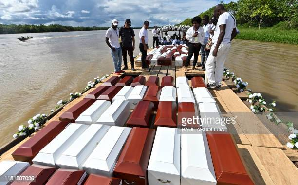 Urns with the remains of victims of Bojaya massacre the single most deadly attack on civilians in Colombia's armed conflict are seen after their...