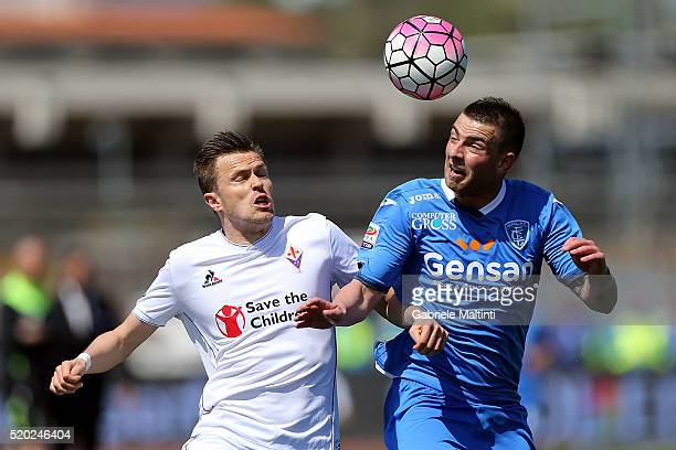 Uros Cosic of Empoli FC battles for the ball with Josip Ilicic of ACF Fiorentina during the Serie A match between Empoli FC and ACF Fiorentina at...