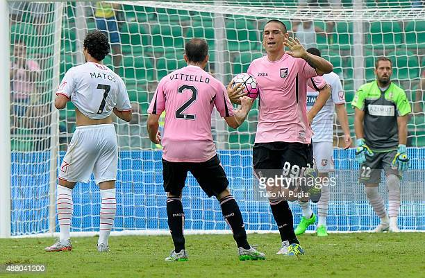 Uros Djurdjevic of Palermo celebrates with team mates after scoring his goal during the Serie A match between US Citta di Palermo and Carpi FC at...