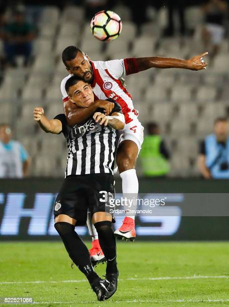 Uros Djurdjevic of Partizan is challenged by Alaixys Romao of Olympiacos during the UEFA Champions League Qualifying match between FC Partizan and...