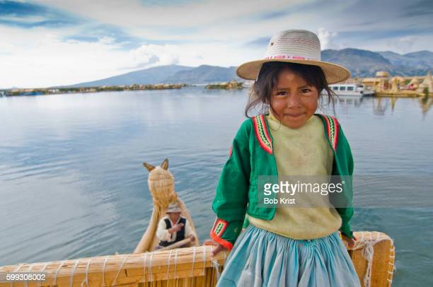 Uros girl on reed boat on Lake Titicaca