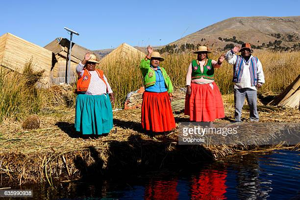 uros indigenous people wearing traditional clothing on floating island - ogphoto stock pictures, royalty-free photos & images