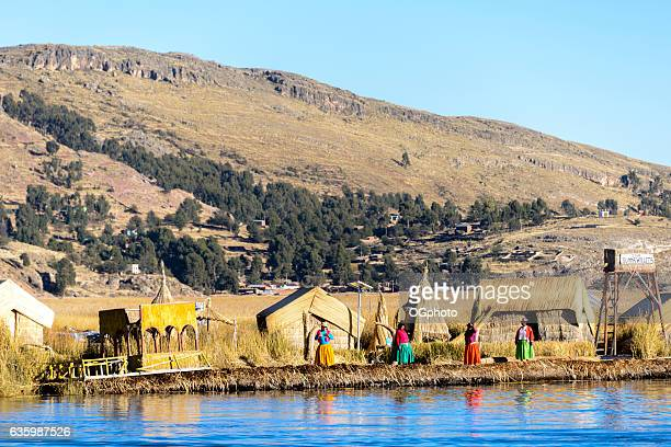 uros indigenous women wearing traditional clothing on floating island - ogphoto stock pictures, royalty-free photos & images