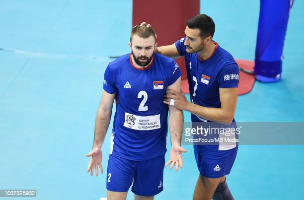 Uros Kovacevic and Patar Krsmanovic of Serbia celebrate after a point during FIVB World Championships match between Serbia and France on September 21...