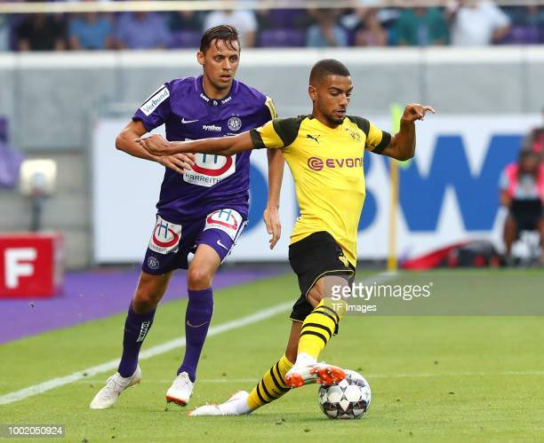 Uros Matic of Austria Wien and Jeremy Toljan of Dortmund battle for the ball during the friendly match between Austria Wien and Borussia Dortmund at...