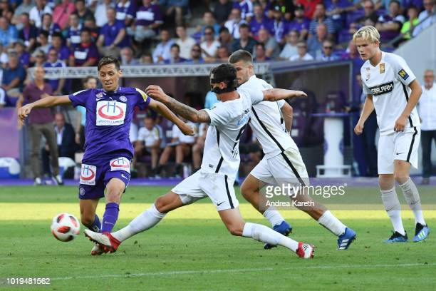 Uros Matic of Austria Wien vies with Bjarne Thoelke of Admira and Dominik Starkl of Admira during the tipico Bundesliga match between FC Admira and...