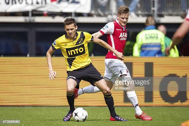 Uros Matic of NAC Breda, Mattias Johansson of AZ during the Dutch Eredivisie match between AZ Alkmaar and NAC Breda at AFAS stadium on May 10, 2015...