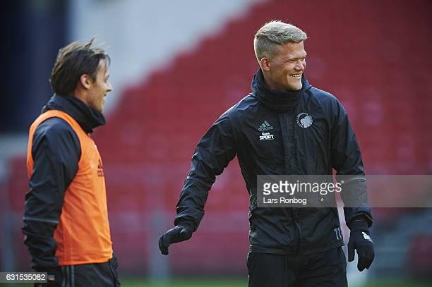 Uros Matic speaks to Andreas Cornelius of FC Copenhagen during the FC Copenhagen training session at Telia Parken Stadium on January 12 2017 in...