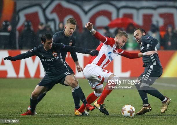 Uros Racic of Crvena Zvezda Alan Dzagoev and Bibras Natcho of CSKA Moscow during UEFA Europa League Round of 32 match between Crvena Zvezda Belgrade...