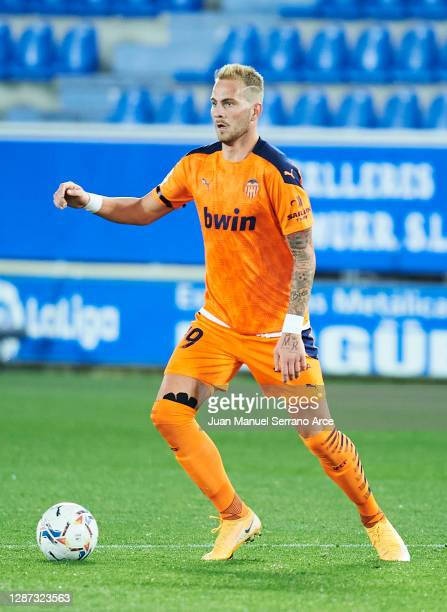 Uros Racic of Valencia CF in action during the LaLiga Santander match between Alaves and Valencia on November 22 2020 in VitoriaGasteiz Spain