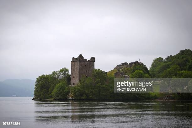 Urquhart Castle is seen from the waters of Loch Ness in the Scottish Highlands Scotland on June 10 2018