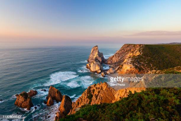 "ursa beach during sunset. praia da ursa, portugal""n - sintra stock pictures, royalty-free photos & images"