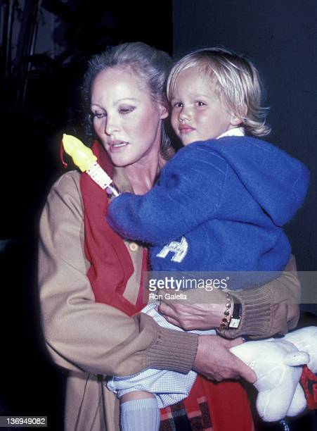 Ursula Andress and son Dimitri Hamlin attend Easter Sunday Brunch on April 11 1982 at the Beverly Hills Hotel in Beverly Hills California