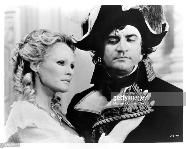 Ursula Andress holds onto Aldo Maccione in a scene from the film 'The Loves And Times Of Scaramouche' 1976