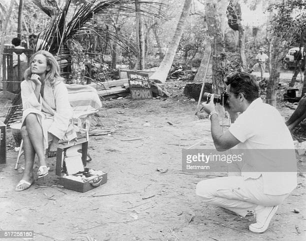 Ursula Andress' husband actor John Derek is the most important visitor to the Jamaica location site as far as she's concerned The tripod behind Derek...