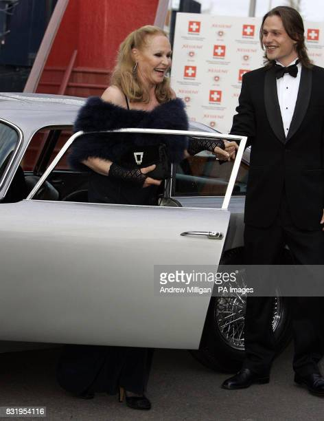 Ursula Andress is helped from car from son Dimitri Hamlin after arriving in the original James Bond Aston Martin DB5 from Goldfinger at the Royal...