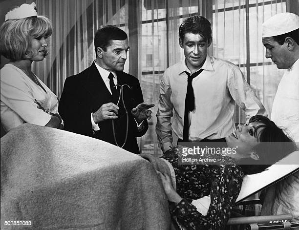 Ursula Andress Paula Prentissand Peter O'Toole are in a hospital in a scene of the movie What's New Pussycat circa 1965