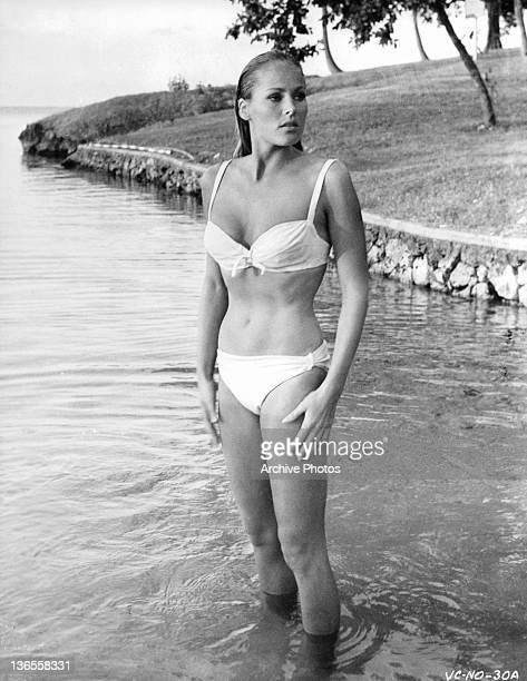 Ursula Andress standing in the water wearing a bikini in a scene from the film 'James Bond Dr No' 1962