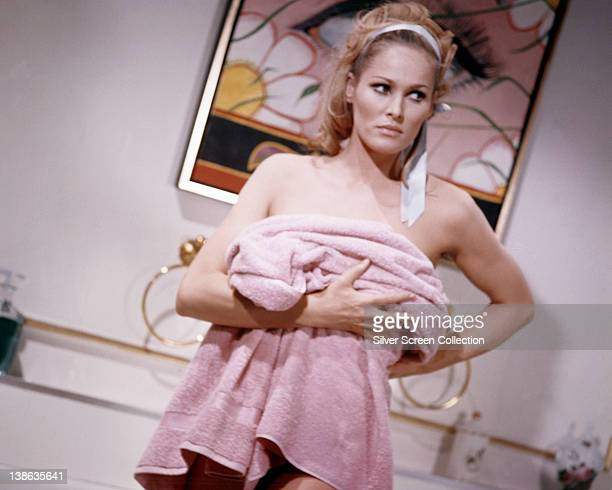 Ursula Andress Swedish actress stands wrapped in a pink towel in an image issued as publicity for the film 'Casino Royale' 1967 The comedy directed...