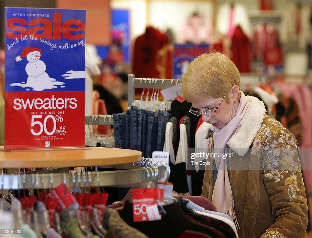 Ursula Braglia shops for discounted sweaters in a Dress Barn store December 27, 2005 in Mount Prospect, Illinois. Retailers are marking down prices as consumers are looking for post-Christmas deals.