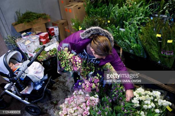 Ursula de Bergevin owner of Fleurs DC looks through flowers with her daughter Chloe while preparing for a Galentine's Day event before Valintine's...