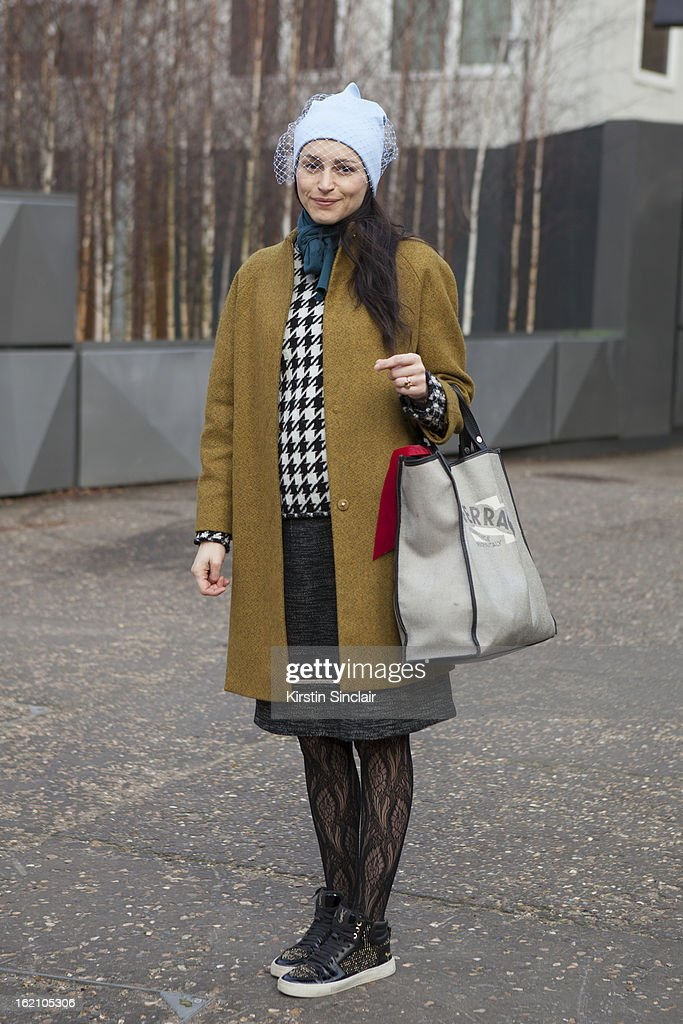Ursula Geisselmnn wearing Jill Sander hat, Cos jacket, Marni skirt, Yves Saint Laurent shoes and Salvatore Ferragamo bag on day 4 of London Womens Fashion Week Autumn/Winter 2013 on February 18, 2013 in London, England.