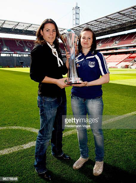 Ursula Holl of FCR 2001 Duisburg and Melanie Groll of FF USV Jena pose with the cup before the DFB press conference of the Women's DFB team on April...