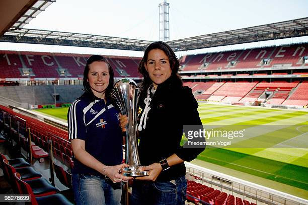 Ursula Holl of FCR 2001 Duisburg and Melanie Groll of FF USV Jena pose with the trophy before the Women's DFB press conference on April 6 2010 in...