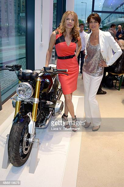 Ursula Karven and Gerit Kling attend Housewarming at BMW Dealership on May 8 2014 in Berlin Germany