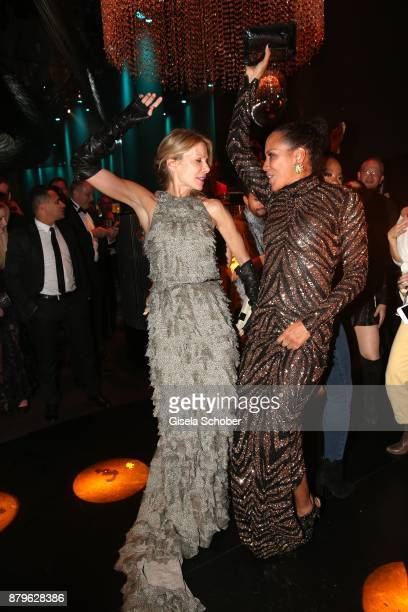 Ursula Karven, Barbara Becker dance during the Bambi Awards 2017 after party at Atrium Tower, Stage Theater on November 16, 2017 in Berlin, Germany.