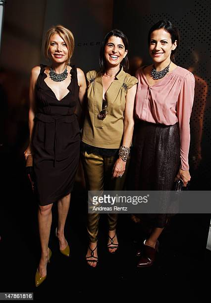 Ursula Karven designer Dorothee Schumacher and Bettina Zimmermann pose backstage prior to the Schumacher show at MercedesBenz Fashion Week...