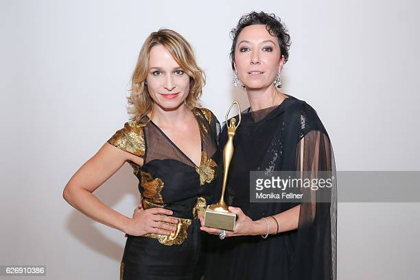 Ursula Strauss presents her award with Mirjam Unger at the Look Women of the Year Awards at City Hall on November 30 2016 in Vienna Austria