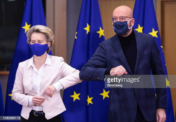 Ursula von der Leyen, European Commission president, left, and Charles Michel, president of the European Council, 'elbow bump' before signing the...