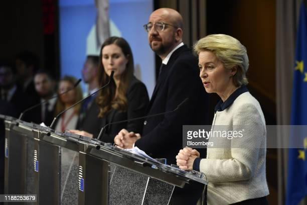 Ursula von der Leyen president of the European Commission right speaks alongside Charles Michel president of the European Union center and Sanna...