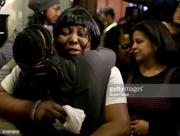 Ursula Ward the mother of Odin Lloyd is comforted after she testified at a House Judiciary Committee hearing in favor of legislation intended to...