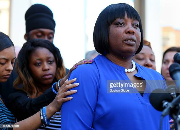 Ursula Ward, the mother of Odin Lloyd, is comforted by Lloyd's girlfriend Shaneah Jenkins, left, and Lloyd's sister Olivia Thibou, middle. Ward spoke...