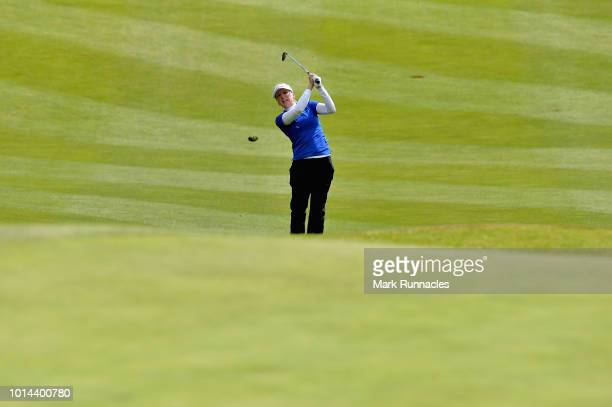 Ursula Wikstrom of Finland takes her third shot on hole eighteen during match 6 of Group C during day three of the European Golf Team Championships...
