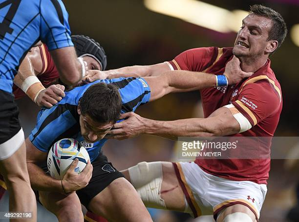Uruguary's scrum half Agustin Ormaechea is tackled by Wales' back row and captain Sam Warburton during the Pool A match of the 2015 Rugby World Cup...