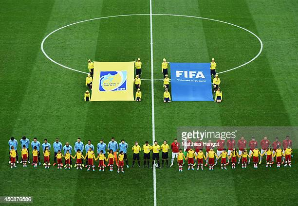 Uruguay and England line up prior to the 2014 FIFA World Cup Brazil Group D match between Uruguay and England at Arena de Sao Paulo on June 19 2014...