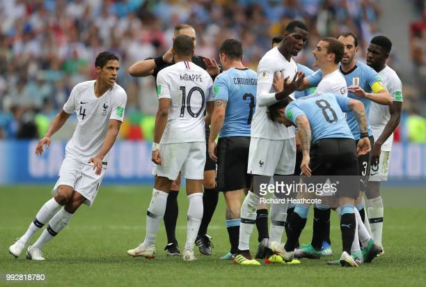 Uruguay and France players clash during the 2018 FIFA World Cup Russia Quarter Final match between Uruguay and France at Nizhny Novgorod Stadium on...