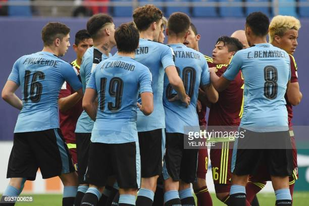 Uruguay and Venezuela's players argue after a tackle during the U20 World Cup semifinal football match between Uruguay and Venezuela in Daejeon on...