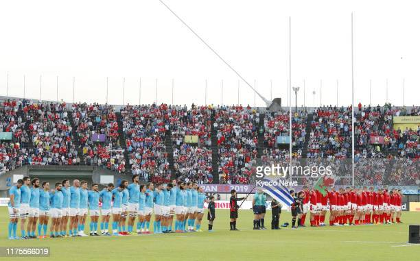 Uruguay and Wales players observe a moment of silence ahead of a Rugby World Cup Pool D match on Oct. 13 in Kumamoto, southwestern Japan, in memory...