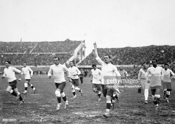 Uruguay captain Jose Nasazzi leads his team on a lap of honour after their 40 victory in the FIFA World Cup match against Romania at the Estadio...