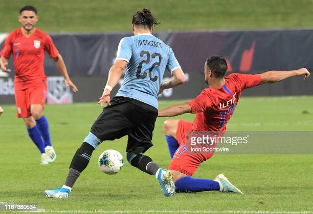 Uruguay defender Martin Caceres and USA midfielder Sebastian Lletget compete for the ball during an exhibition soccer match between the US Mens...