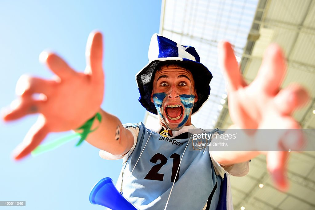 A Uruguay fan cheers prior to the 2014 FIFA World Cup Brazil Group D match between Uruguay and Costa Rica at Castelao on June 14, 2014 in Fortaleza, Brazil.