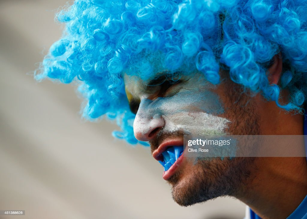 A Uruguay fan wears false teeth ahead of the 2014 FIFA World Cup Brazil round of 16 match between Colombia and Uruguay at Maracana on June 28, 2014 in Rio de Janeiro, Brazil.