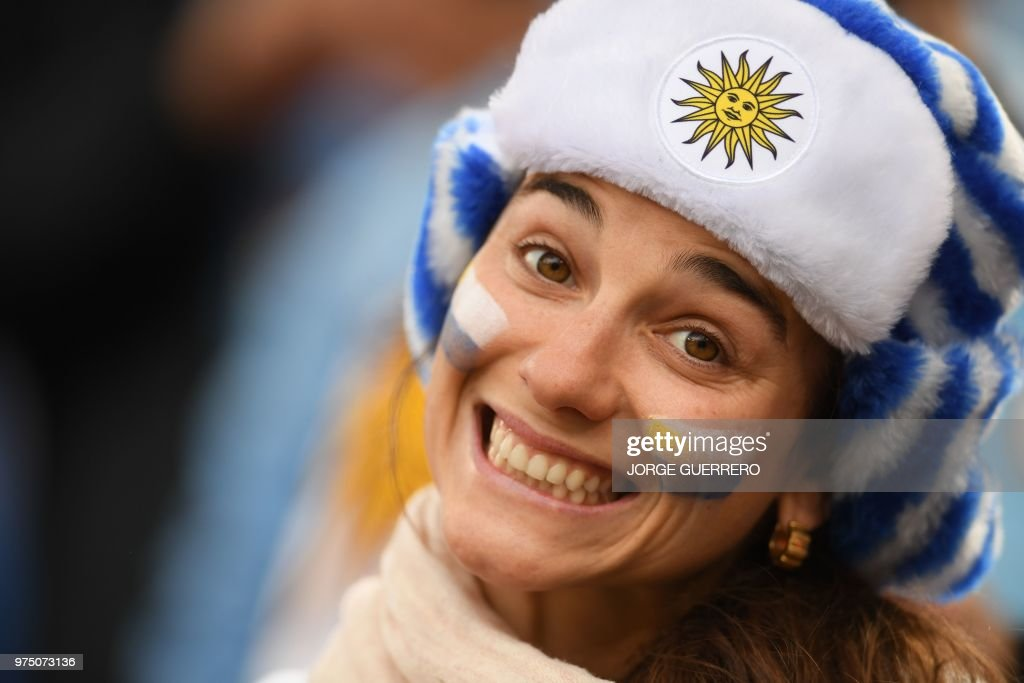 Uruguay fan with a painted face is seen before kick off of the Russia 2018 World Cup Group A football match between Egypt and Uruguay at the Ekaterinburg Arena in Ekaterinburg on June 15, 2018. (Photo by JORGE GUERRERO / AFP) / RESTRICTED