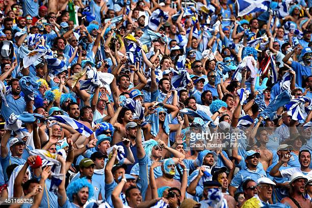 Uruguay fans celebrate their team's first goal during the 2014 FIFA World Cup Brazil Group D match between Italy and Uruguay at Estadio das Dunas on...